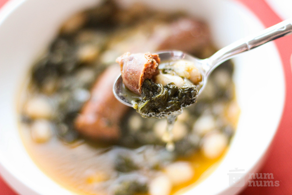 daniel boulud\'s spicy merguez with spinach and white beans